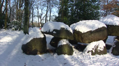 Snow covered megalithic tomb or hunebed, archeological monument Stock Footage