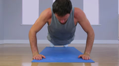 Attractive sporty man doing press ups Stock Footage