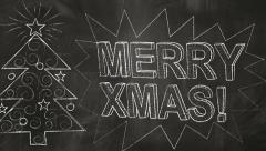 Drawing merry christmas greetings on blackboard Stock Footage