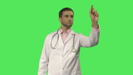 Stock Video Footage of Mature Male doctor pointing at screen