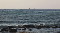 Mediterranean sea in Paphos city with ship is stranded or grounded on horizon Stock Footage