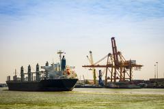 Vessel cargo with crane Stock Photos