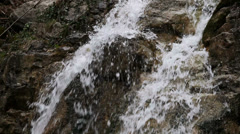 Waterfall. the stream of water flowing over rocks Stock Footage