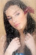 Woman behind glass full of water drops Stock Photos