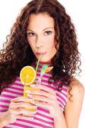 Woman drink orange juice, isolated Stock Photos