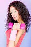 curls hair girl holding weight for exercise - stock photo