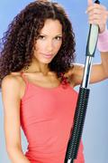woman training with power twister - stock photo
