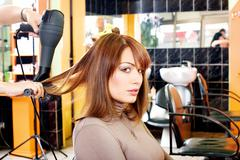 satisfied customer in a hair salon - stock photo