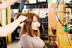 hairdresser makes a hair dress - stock photo