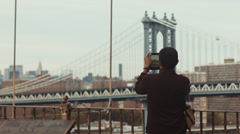 NYC Tablet Man Manhattan Bridge Stock Footage