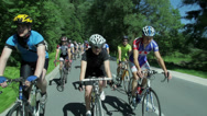 Stock Video Footage of Crowd of cyclist driving through countryside