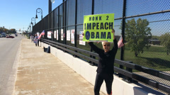 Protesters with Impeach Obama signs - stock footage