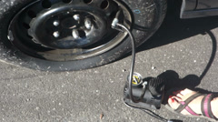 pumping pump tire air inflate - stock footage
