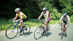 Hill climbing cycling competition - stock footage