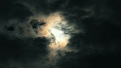 Moon shrouded by moving clouds - dark Timelapse Stock Footage