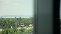 Lake Balaton and nature landscape through a window Stock Footage