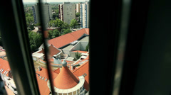 Cityscape view through window while sliding Stock Footage