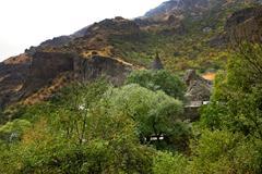 geghard monastery and cliffs in armenia - stock photo
