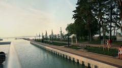 Traveling with boat on Lake Balaton by a park in Hungary Stock Footage