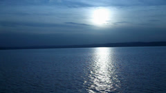 Wide shot of sunset on Lake Balaton in Hungary with blue filter Stock Footage