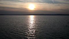 Traveling on Lake Balaton at sunset in Hungary Stock Footage