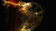 Deepwater construction vessel DCV Aegir by night - Close up wheel + zoom out Stock Footage