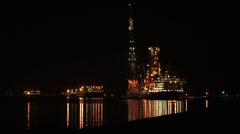 Basin by night + illuminated deepwater construction vessel DCV Aegir Stock Footage