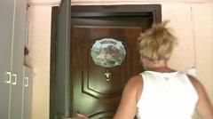 Woman closing the door Stock Footage
