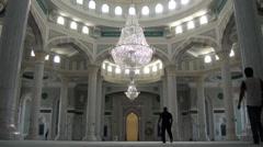 People enter beautiful new mosque in Astana, Kazakhstan Stock Footage