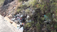 Litter in bushes top view 2 Stock Footage