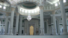 Praying alone in beautiful new mosque, Astana, Kazakhstan, Central Asia Stock Footage