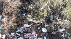 Dump in bushes top view Stock Footage