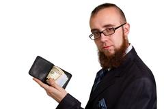 businessman in glasses holding dollars - stock photo