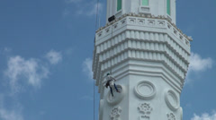 Painting a minaret in Astana, Kazakhstan Stock Footage