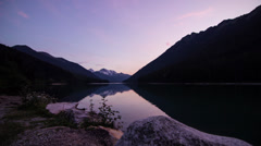 Motion dolly time lapse shot of sunset at duffey lake - stock footage