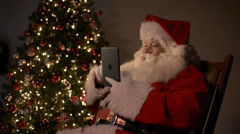 Santa black tablet Stock Footage