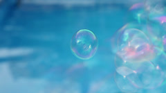 Soap bubbles at pool Stock Footage