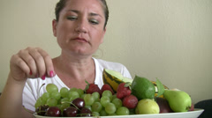 Woman eating fruit Stock Footage