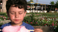Stock Video Footage of Little boy eating Cotton candy3