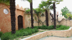 Kid walking next to old arabic houses on windy day Stock Footage