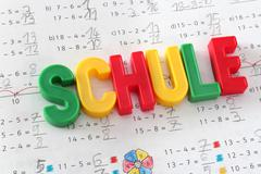 school, word in german language - stock photo