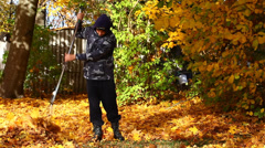 People collects leaves in the fall episode 7 - stock footage