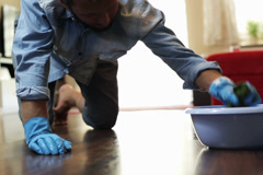 Man cleaning the floor Stock Footage