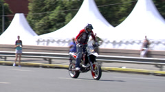 Motorcycle rider riding fmx show Stock Footage