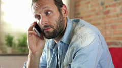 Man with the cellphone receiving bad news - stock footage