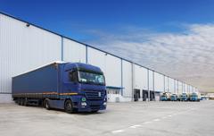 Truck, warehouse building Stock Photos