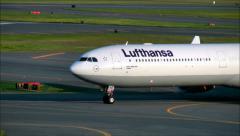 Lufthansa name on airplane front Stock Footage