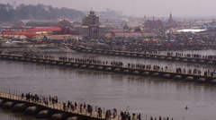 Crowd Crossing Pontoon Bridges at Kumbh Mela Festival in Allahabad, India Stock Footage