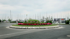 Flower arranged roundabout at sea side Stock Footage