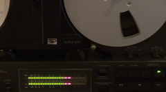 Classic reel to reel tape recorder, led lights VU meter, hand rewind audio tape Stock Footage